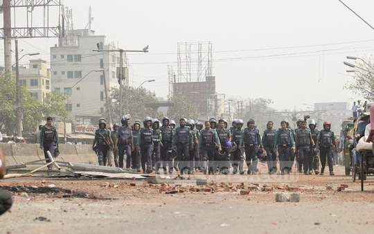 Policemen guard a Gabtali street after agitations by transport workers during their strike. Photo: asif mahmud ove