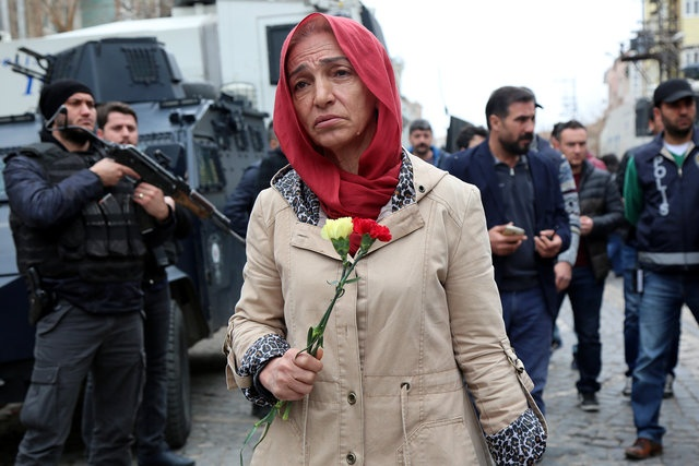 An activist walks in the historical Sur district to promote an International Women's Day rally to be held March 8, in the Kurdish-dominated southeastern city of Diyarbakir, Turkey March 1, 2017. Reuters