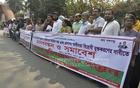 'Amra Muktijoddhar Sontan' [we are children of the freedom fighters] form human chain in front of the National Press Club on Friday. They demonstration was made to protest government decision to employ from the BCS merit list to fill in for the insufficient applicants in freedom fighters' quota.