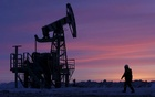 Oil edges higher on weaker dollar after sell-off