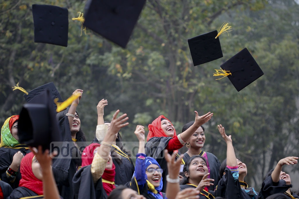 Dhaka University graduates throw their hats during the 50th Convocation of the oldest university in Bangladesh on Thursday. Photo: asaduzzaman pramanik