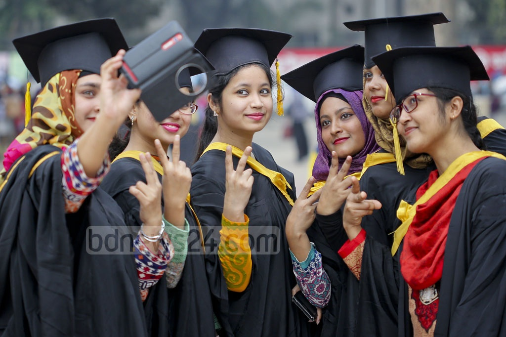 Selfie galore of graduates during 50th Convocation of Dhaka University on Thursday. Photo: asaduzzaman pramanik