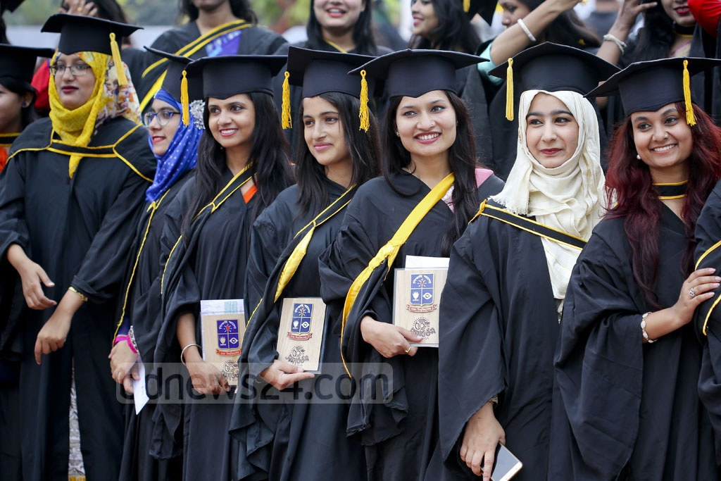 Graduates wearing convocation gowns and hats pose for photograph at the 50th Convocation of Dhaka University on Saturday. Photo: asaduzzaman pramanik