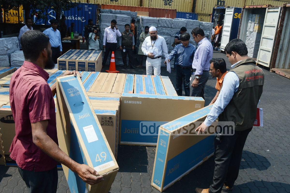Customs Intelligence officials seize illegally imported LED televisions and cigarettes at Chittagong port. Photo: suman babu