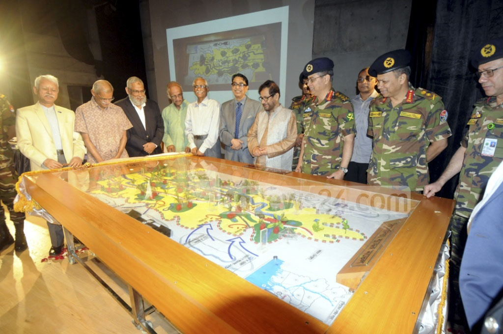 Cultural Affairs Minister Asaduzzaman Noor takes a look at the model demonstrating strategies adopted by freedom fighters in Feni during 1971 Liberation War. Bangladesh Army handed the model to the Liberation War Museum in Dhaka on Sunday.