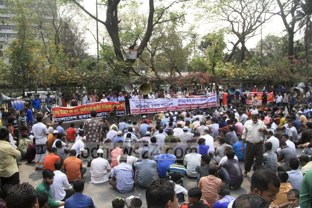 Bangladesh Hawker Sangram Parishad organise a rally in front of the National Press Club on Sunday against eviction from pavements.