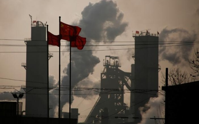 Chinese national flags are flying near a steel factory in Wu'an, Hebei province, China, Feb 23, 2017. Reuters