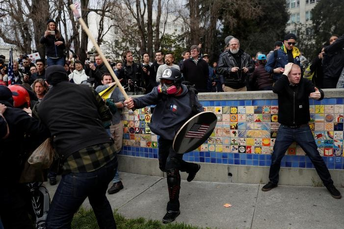 A demonstrator in support of US President Donald Trump swings a stick towards a group of counter-protesters during a 'People 4 Trump' rally in Berkeley, California March 4, 2017. REUTERS