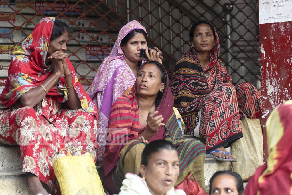 Women daily wage-earners wait for job at Mirpur -- they get TK 350-400 a day , but men get atleast TK 500. Photo: asif mahmud ove
