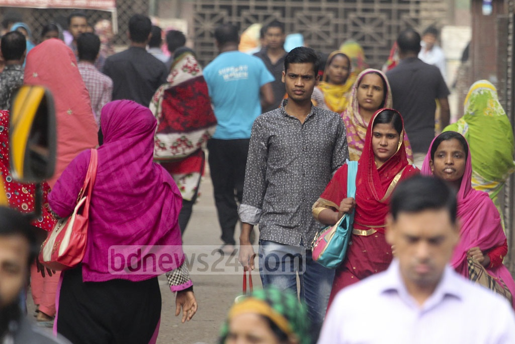 Women leave for work at garment industries, the nation's major source of export earnings. Photo: asif mahmud ove