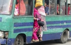 Women take much risk to find a place in crowded public transport on way to office. Photo: asif mahmud ove