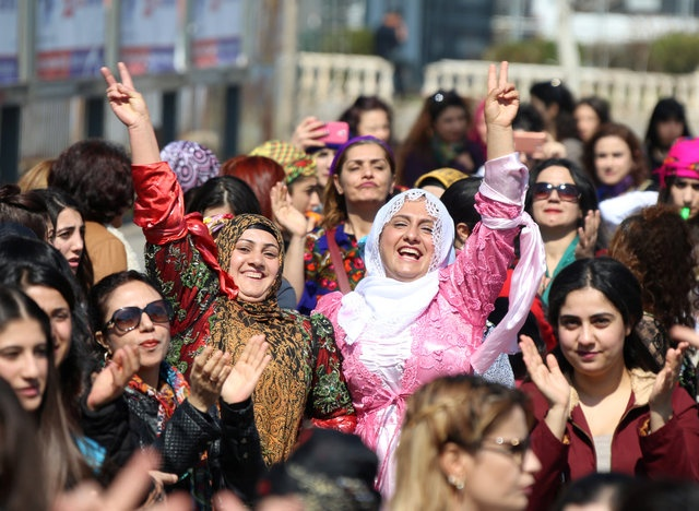 Participants dance during an International Women's Day rally in the Kurdish-dominated southeastern city of Diyarbakir, Turkey March 8, 2017. Reuters