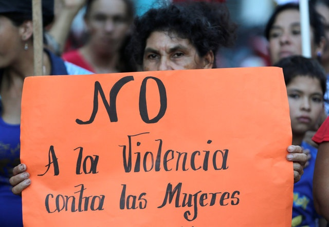 Paraguayan social activists protest in front of the Health Ministry to demand the end of violence against women and better health care for women, as the world celebrates