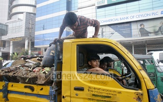 Thirteen-year-old 'Shohag' drives the pick-up truck owned by his uncle, who rented it out to the Dhaka City Corporation for transporting garbage. Photo: tanvir ahammed/bdnews24.com