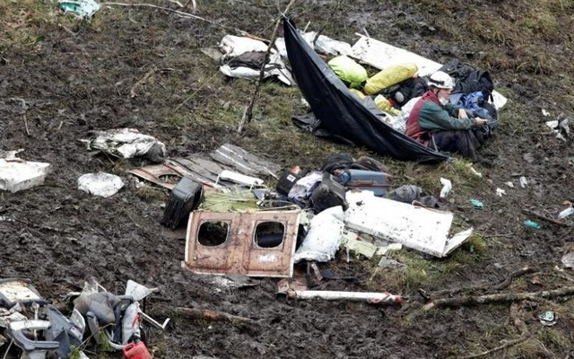 FILE PHOTO: A rescue worker sits near the wreckage of a plane that crashed into the Colombian jungle with Brazilian soccer team Chapecoense onboard near Medellin, Colombia, November 29, 2016. Reuters
