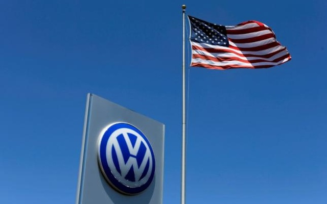 A US flag flutters in the wind above a Volkswagen dealership in Carlsbad, California, US May 2, 2016. Reuters