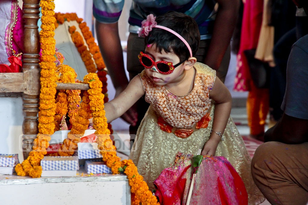 A child at the Dhakeshwari National Temple during Dol festival on Sunday. Photo: tanvir ahammed
