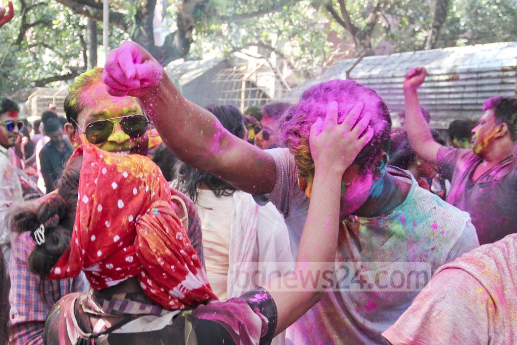 Students of Dhaka University celebrate Doljatra by smudging each other's face with colours on Monday. Photo: asif mahmud ove