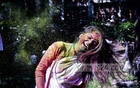 Students of Dhaka University celebrate Doljatra by smudging each other's face with colours on Monday. Photo: abdul mannan