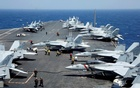 US Navy F18 fighter jets are pictured on the flight deck of aircraft carrier USS Carl Vinson during a routine exercise in South China Sea, Mar 3, 2017. Reuters