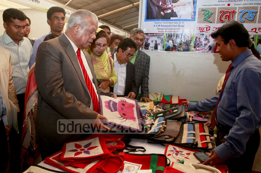 Industries Minister Amir Hossain Amu visits a stall after inaugurating the National SME Fair 2017 on Wednesday. Photo: asaduzzaman pramanik