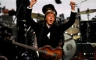 FILE PHOTO - Paul McCartney celebrates after performing with Ringo Starr (not pictured) during the 2015 Rock and Roll Hall of Fame Induction Ceremony in Cleveland, US on Ohio April 18, 2015. Reuters