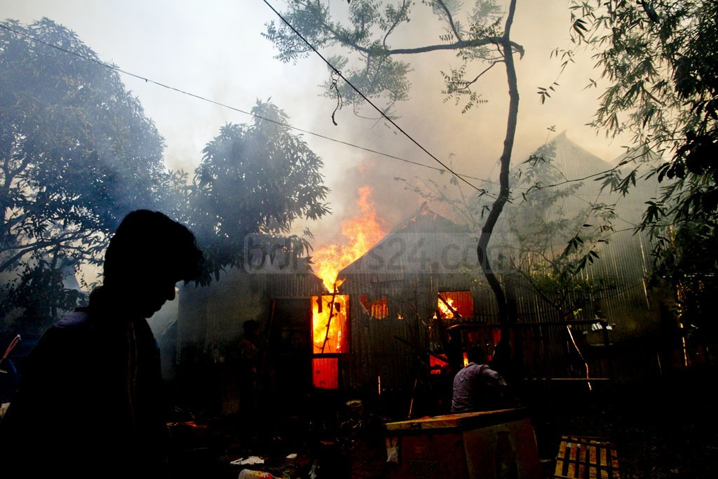 Many houses at one of the largest slums in Dhaka razed to the ground by a fire that broke out at the early hours of Thursday. It took fire-fighters over five hours to put out the flames. Photo: tanvir ahammed