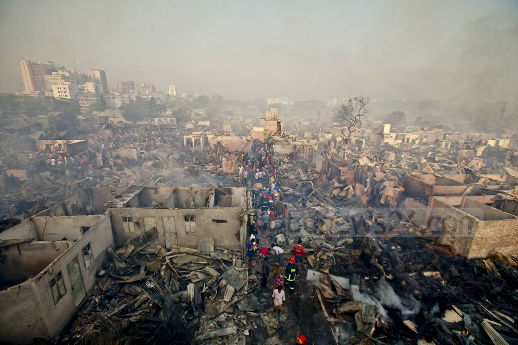 Residents of Dhaka's Korail slum search for their belongings after many houses at one of the largest slums in the capital were gutted in a fire on Thursday. Photo: tanvir ahammed