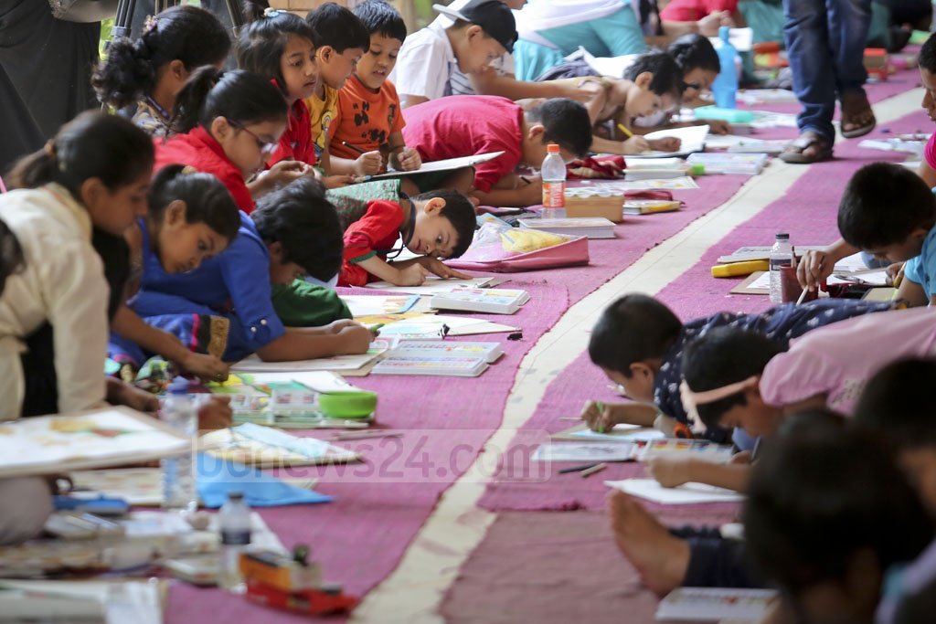 Children participate at a painting competition at Dhaka University's Faculty of Fine Arts on the 97th birth anniversary of Bangabandhu Sheikh Mujibur Rahman and National Children's Day on Friday. Photo: asaduzzaman pramanik