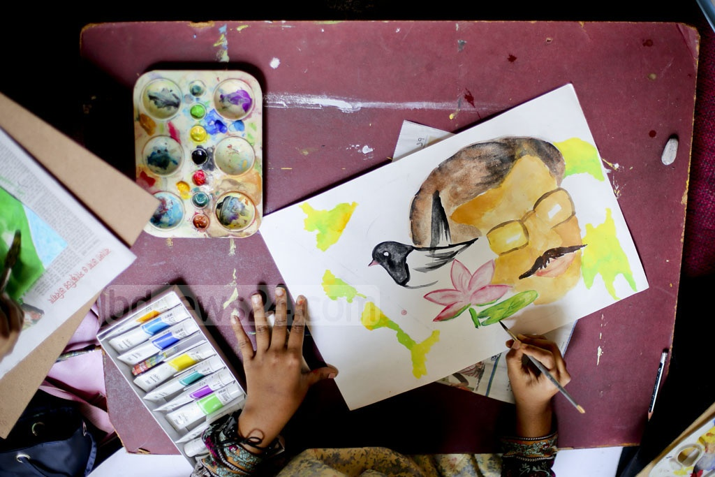 A child painting during a competition at Dhaka University's Faculty of Fine Arts on Friday. 'Bangali Sangskritik Jote' organised the competition marking the 97th birth anniversary of Bangabandhu Sheikh Mujibur Rahman and National Children's Day. Photo: asaduzzaman pramanik