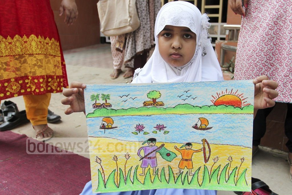 A child shows a painting of Bangabandhu at a competition in Dhaka's Pallabi on Friday to mark Bangabandhu's 97th birth anniversary and National Children Day. Photo: asif mahmud ove