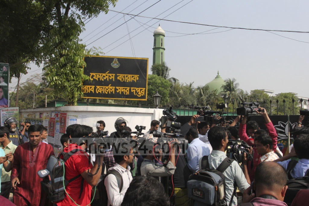 Reporters flock the entrance to the site in Dhaka's Ashkona where the RAB's new headquarter is being constructed. A man, believed to a suicide bomber, died in a blast after reportedly trying to climb over the wall. Photo: asif mahmud ove