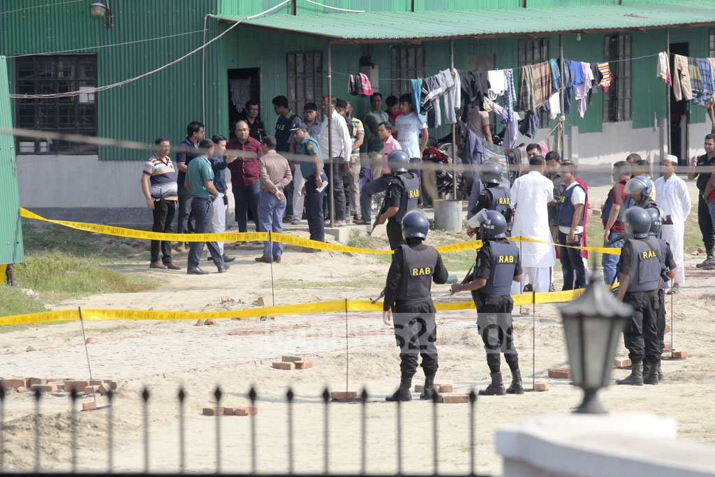 Investigators demarcated the scene of the 'suicide attack' with yellow ribbon at a makeshift camp of RAB near Ashkona Hajj Camp on Friday.