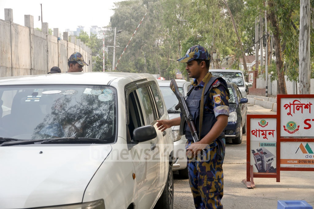 After two attempted suicide attacks on RAB - one in Ashkona and the other in Khilgaon, security has been tightened in capital's diplomatic zone in Gulshan and Baridhara. The picture is taken from a makeshift police checkpoint at Gulshan on Saturday. Photo: tanvir ahammed