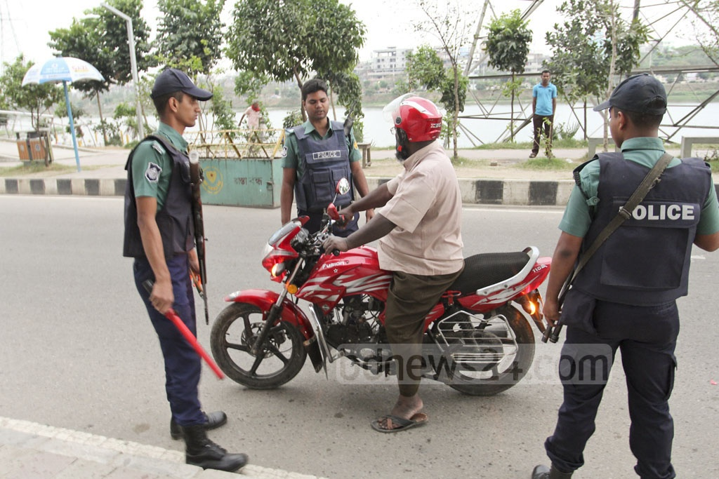 After two attempted suicide attacks on RAB - one in Ashkona and the other in Khilgaon, security has been tightened in and around the capital. The picture is taken from a makeshift police checkpoint at Hatirjheel on Saturday. Photo: asif mahmud ove