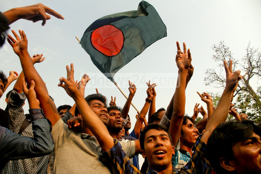 The Bangladesh flag flies high in the Dhaka University area as cricket fans celebrate the Tigers' four-wicket Test win over Sri Lanka in Colombo on Sunday. Photo: tanvir ahammed