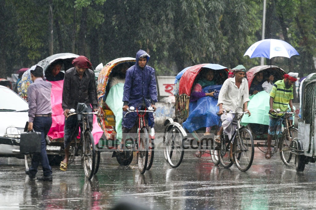 Rain in Chaitra: The capital and other parts of the country experience rain at the beginning of 'Chaitra', the second month of spring in Bangla calendar, due to a low over the Bay. The photo was taken from Dhaka University area on Monday. Photo: abdul mannan