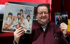 French Beatles specialist and collector Jacques Volcouve, one of the world's greatest living experts of the band, poses with the ' Yesterday And today ' and 'From Me To You' covers at Drouot auction house in Paris, March 16, 2017, a part of the 15,000 items going on sale on next March 18. Reuters