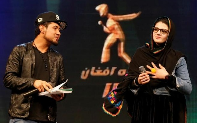 Zulala Hashimi, 18 (R) and Sayed Jamal Mubarez, 23 (L) singer finalists of the music contest 'Afghan Star', rehearse for the show in Kabul, Afghanistan Mar 19, 2017. Reuters