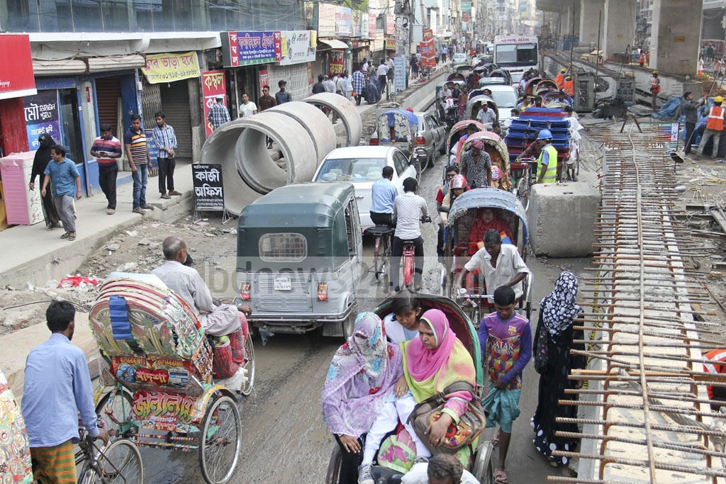 Much of the road space is occupied by ongoing construction of flyover and sewerage renovation at Malibagh level-crossing, leading to traffic snarls. Photo: asif mahmud ove