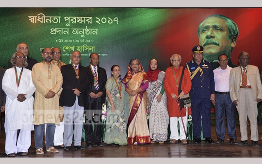 Prime Minister Sheikh Hasina pose for photo with the winners of Swadhinata Puroskar (Independence Award) 2017 at the Osmani Memorial Auditorium in Dhaka on Thursday. Photo: PID