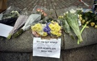 Floral tributes are seen in Westminster the day after an attack, in London, Britain March 23, 2017. Reuters