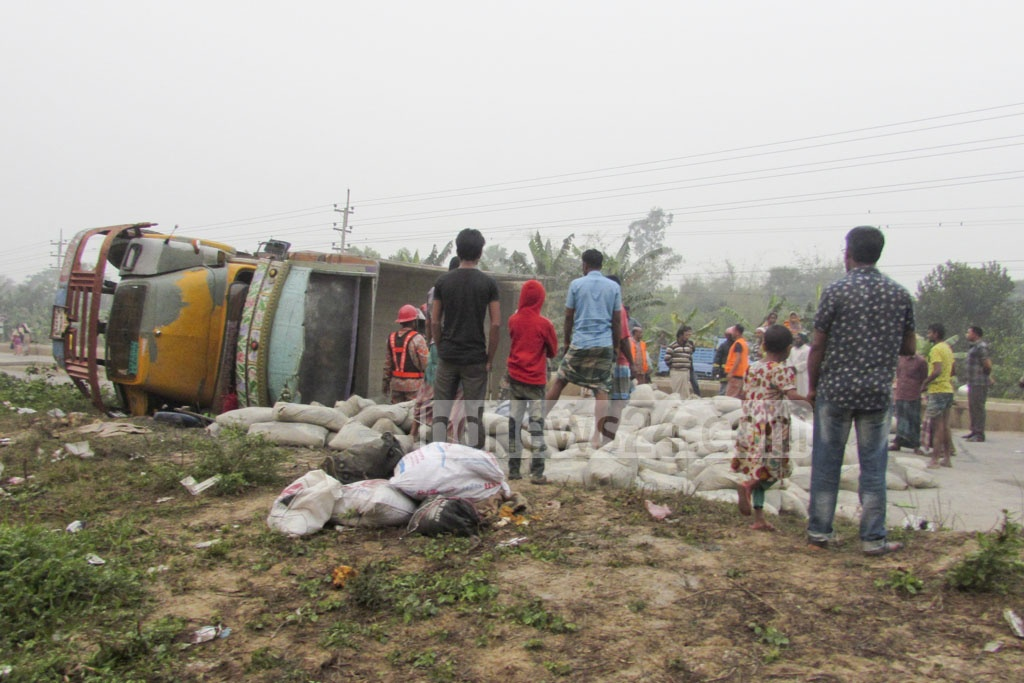 Ten people seated on these cement sacks for a cheap ride to Jamalpur died after the vehicle overturned at Myemnsingh's Bhaluka on the Dhaka-Mymensingh Highway on Friday.