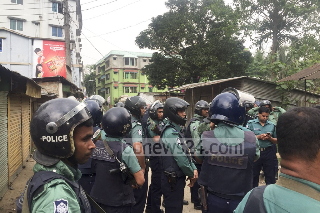 Policemen guard a perimeter around a building with a suspected militant hideout at Shibbari of Sylhet's South Surma on Friday.