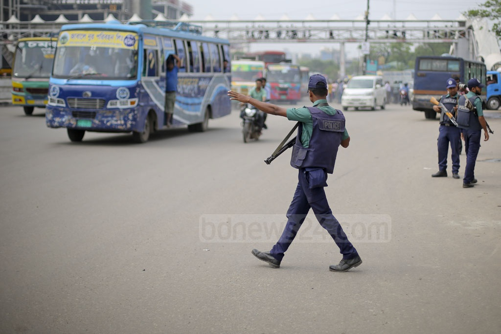 Police go about their work at the police box in front of Dhaka's Shahjalal International Airport on Saturday. A man carrying a bomb had been killed near this location after an explosion on Friday. Photo: asaduzzaman pramanik
