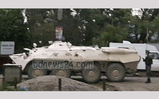 An armoured vehicle is seen outside a suspected militant den in Sylhet's Shibbarhi on Saturday.