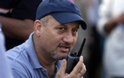 This April 2002 photo shows Bollywood actor Anupam Kher talking on a walkie-talkie while directing his Hindi film 'Om Jai Jagdish' in Mumbai, India. Reuters