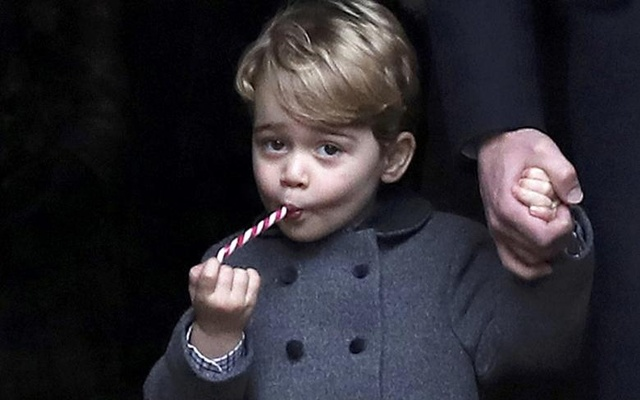 Prince George, the son of the Duke and Duchess of Cambridge, sucks a sweet as he leaves following the morning Christmas Day service at St Mark's Church in Englefield, near Bucklebury in southern England, Britain, December 25, 2016. Reuters