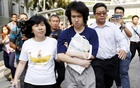 Teen blogger Amos Yee leaves with his parents after his sentencing from the State Court in Singapore Jul 6, 2015. Reuters