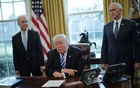 US President Donald Trump talks to journalist at the Oval Office of the White House after the AHCA health care bill was pulled before a vote, accompanied by US Health and Human Services Secretary Tom Price (L) and Vice President Mike Pence, in Washington, US, March 24, 2017.